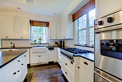 black granite white cabinets Granite kitchen T & T Stone